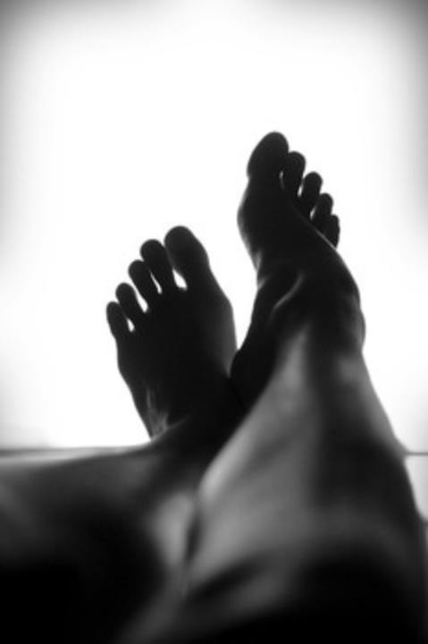 Black and white person feets pedicure medium